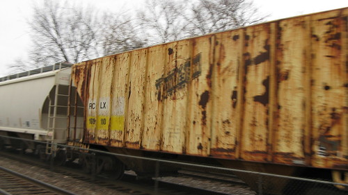 A former Chicago & NorthWestern Railroad covered hopper car in transit.  Riverside Illinois USA.  Sunday, November 20th, 2011. by Eddie from Chicago