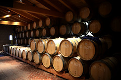 wine(0.0), alcoholic beverage(0.0), wood(1.0), barrel(1.0), winery(1.0), lighting(1.0),