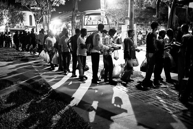 Migrant workers queuing up orderly for their buses to go back to their dormitories. This picture essay was taken before the riot of 8th Dec.