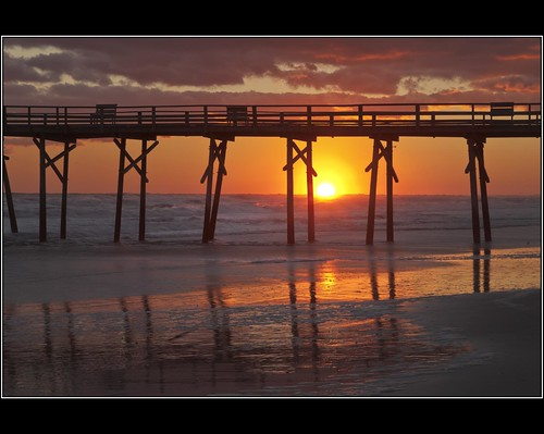 ocean sunset sun reflection beach water pier nc northcarolina settingsun atlanticbeach crystalcoast oceanana paulmalcolm oceananafishingpier