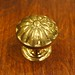 "Dimensions: 1-1/2""D x 1-3/8""H   Material: brass (unlacquered)  *This knob is unlacquered solid brass.  They will tarnish over time to a warm patina.  We can also darken them to an antique brass or oil-rubbed bronze finish for a nominal fee*  Please contact us for current availability and pricing"