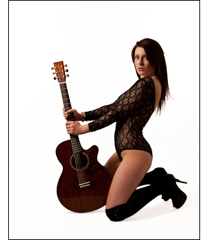 Makeovers and Photo Shoot, woman brings her guitar as a prop in this glamour photograph.