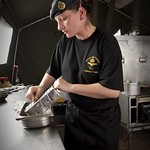 Royal Air Force Chef Prepares Food in a Field Kitchen