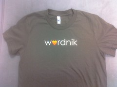 arm(0.0), neck(0.0), long-sleeved t-shirt(0.0), pocket(0.0), active shirt(1.0), clothing(1.0), white(1.0), sleeve(1.0), shirt(1.0), brand(1.0), t-shirt(1.0),