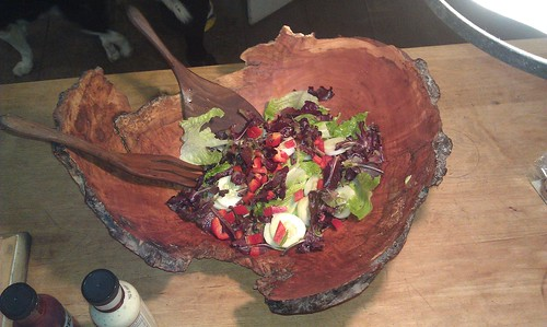 Salad in a beautifully carved wooden bowl