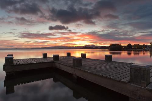 light lake clouds sunrise jetty first