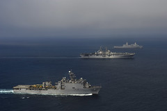 In this file photo, the Makin Island Amphibious Ready Group, consisting of USS Pearl Harbor (LSD 52), USS Makin Island (LHD 8) and USS New Orleans (LPD 18) transit together in the Pacific Ocean Oct. 11 while conductin deployment preparations. (U.S. Navy photo by Chief Mass Communication Specialist John Lill)