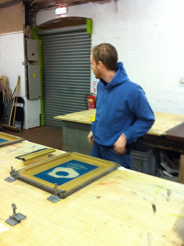 Julian Sykes getting ready to screen print