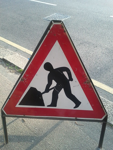 Umbrella man road works sign