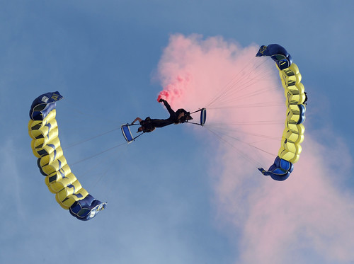 The U.S. Navy parachute demonstration team, the Leap Frogs, perform a down-plane maneuver during the 2011 Central Valley Air Show at Naval Air Station Lemoore.