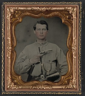 [Unidentified soldier in Confederate uniform with gun] (LOC)