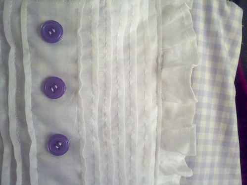 Ruffle bib dress close up