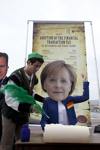 Oxfam activist as Merkel poses with Robin Hood