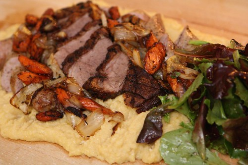 Roasted Duck Breast, Sausage, and Vegetables on Creamy Polenta