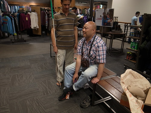 Me Trying on Merrell Shoes, Daniel Standing Nearby