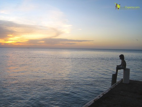 view of dock sunset luxury boutique hotel west bay, roatan honduras
