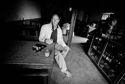 Self portrait of the photographer, having his tea at the Namo Buddha Monastery cantine affter the morning prayers..Autoretrato del fotografo tomando té en el Monasterio Namo Buddha después de los rezos de la mañana by Harry Fisch