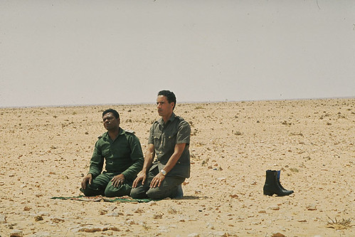 Col. Muammar Gaddafi and Major-General Abu-Bakr Yunis Jaber during the early days of the Al-Fateh Revolution in Libya. The gains of the Green Revolution are being systematically dismantled by the US-NATO occupation and its puppets. by Pan-African News Wire File Photos