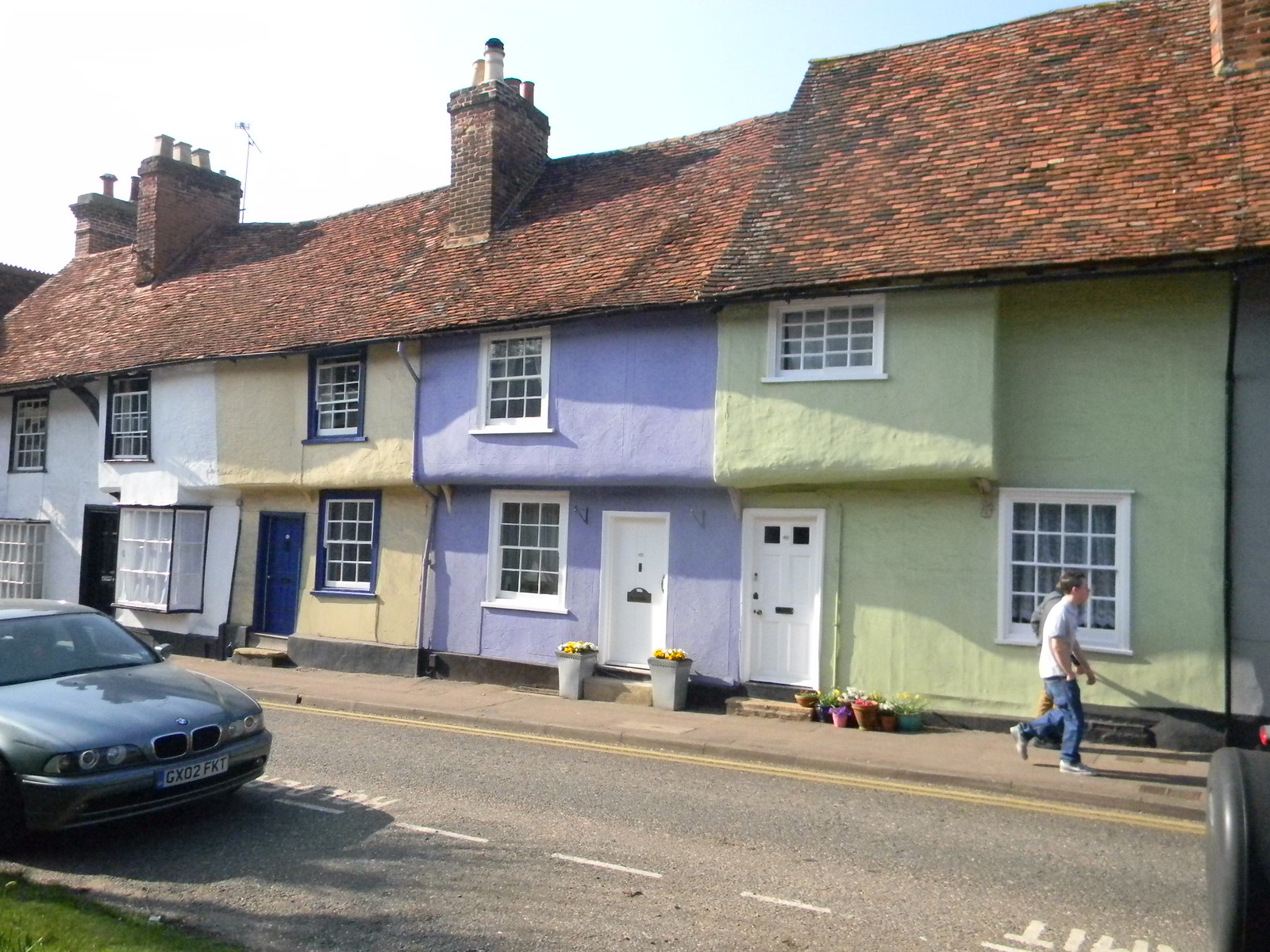Pastel pargeted cottages Saffron Walden Great Chesterford to Newport