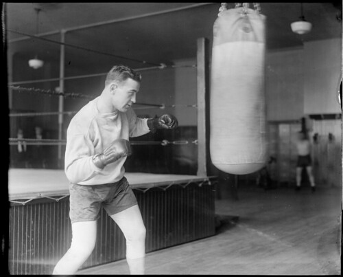 Jim Maloney, local boxer, working the heavy bag