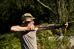firearm(0.0), skeet shooting(0.0), weapon(1.0), sports(1.0), recreation(1.0), outdoor recreation(1.0), bow and arrow(1.0),