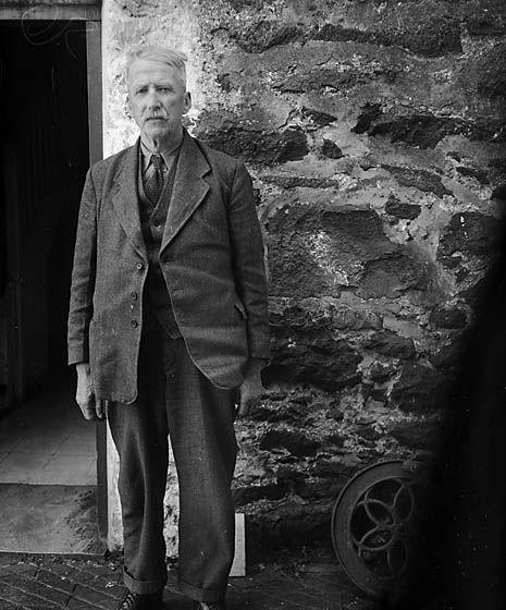 [The poet Robert Evans (Cybi), outside his home, Bryn Eithin, Llangybi]
