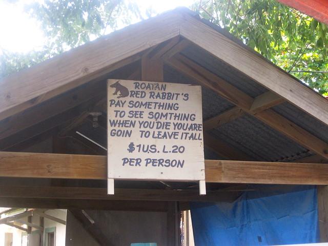 odd sign in west end roatan honduras