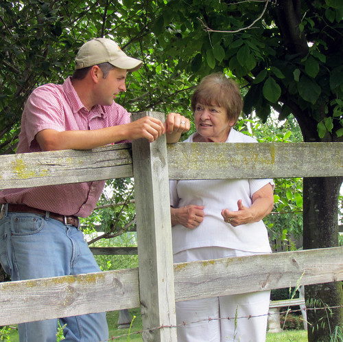 Harrisonburg District Conservationist Cory Guilliams chats with Janet Kline on a site visit to her farm.