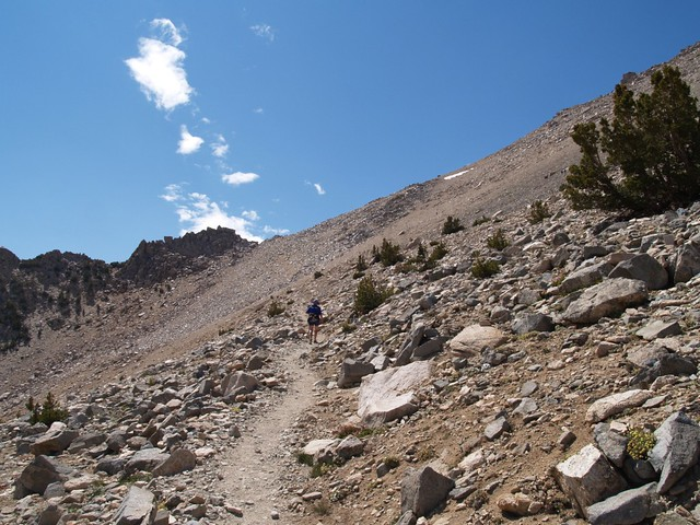 Hiking the final scree and talus field approaching Kearsarge Pass