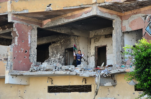 Child with his mother inside a bombed Misrata building