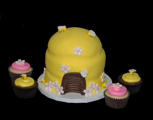pink and yellow bumble bee themed cupcake tower topper cake