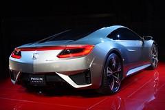 acura(0.0), automobile(1.0), automotive exterior(1.0), wheel(1.0), vehicle(1.0), performance car(1.0), automotive design(1.0), auto show(1.0), honda(1.0), honda nsx(1.0), bumper(1.0), concept car(1.0), land vehicle(1.0), coupã©(1.0), supercar(1.0), sports car(1.0),