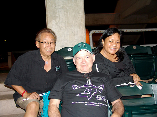 <p>Chancellor Michael Rota, center, and Honolulu staffers rooted for the Dillinghammas at the the UH AUW Softball Tourment at Les Murakami Stadium on Sept. 30, 2011</p>