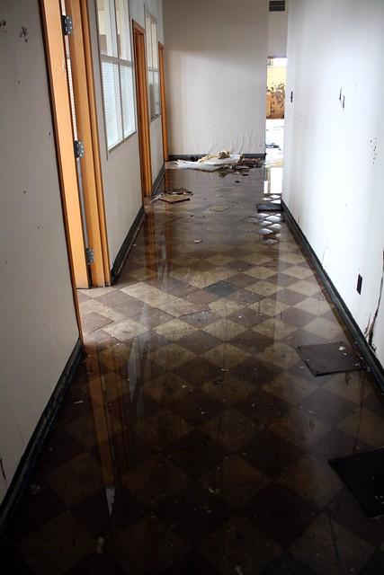 Flooded asbestos tiled hallway