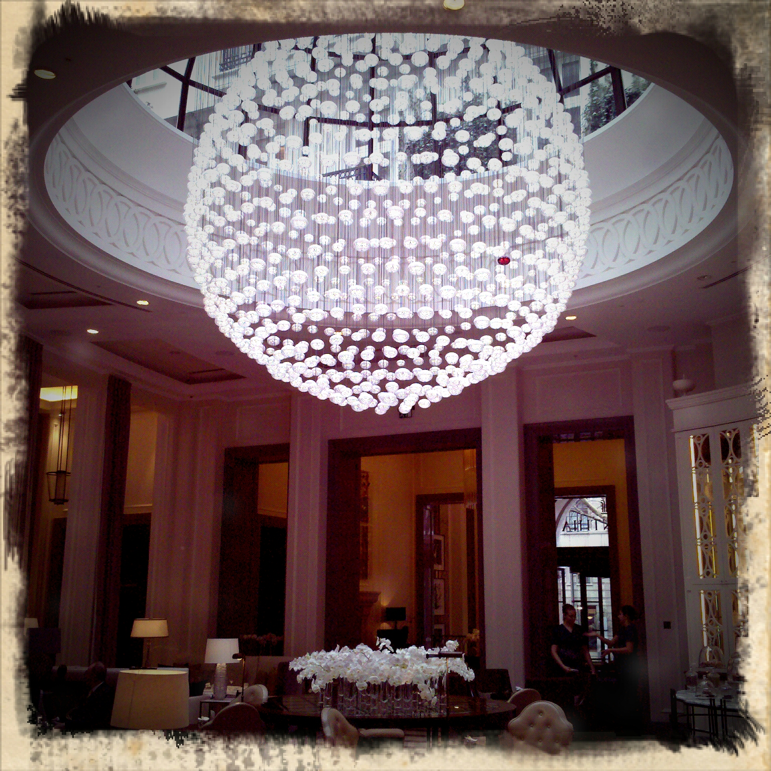 Small Globe Chandelier Over Dining Room