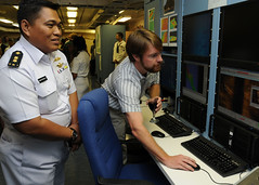 JAKARTA, Indonesia (Nov. 16, 2011) Matt Weathers, attached to the Naval Oceanographic Office (NAVOCEANO), explains surveying equipment to an Indonesian Navy officer aboard the Military Sealift Command (MSC) oceanographic survey ship USNS Henson (T-AGS 63) during an event marking the conclusion of a month-long bilateral survey mission. (U.S. Navy photo by Mass Communication Specialist 2nd Class Jessica Bidwell)