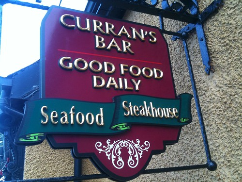 CURRAN'S BAR BESPOKE CARVED PROJECTING SIGN