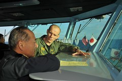 PACIFIC OCEAN (Oct. 31, 2011) Rear Adm. John Haley, commander of Carrier Strike Group 5 and Task Force 70, right, discusses Annual Exercise (ANNUALEX) 2011 with Vice Adm. Katsutoshi Kawano, commander in chief, Self-Defense Fleet, Japan Maritime Self Defense Force (JMSDF), on the Flag bridge aboard the aircraft carrier USS George Washington (CVN 73). (U.S. Navy photo by Mass Communication Specialist 2nd Class William Pittman)