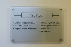 Internal landing directional sign