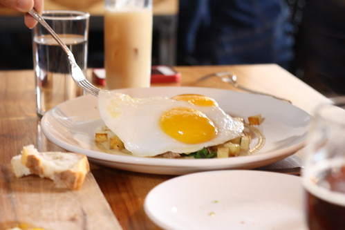 Sunny Side Duck Egg Hash with Duck Confit, Nichols Farm Spring Onions, Yukon Gold Potato, Black Truffle Vinaigrette