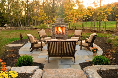 outdoor furniture on patio with fireplace