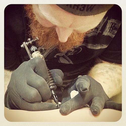 Getting tattooed.