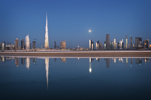 morning light moon water glass skyline buildings reflections dawn early dubai skyscrapers uae middleeast fullmoon burjdubai d300s catalinmarin momentaryawecom burjkhalifa