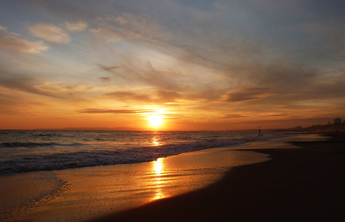 Take an autumn walk along the beach at sunset.