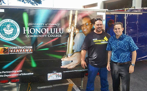 <p>Construction Academy Instructor Chris Kuahine showed off Honolulu Community College's welding and sheetmetal traveling trailer to Lt. Gov. Brian Schatz.</p>