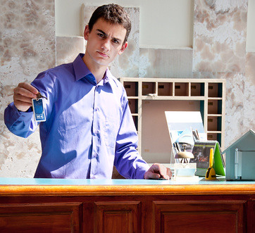 Hotel Receptionist Young Man At The Reception Giving
