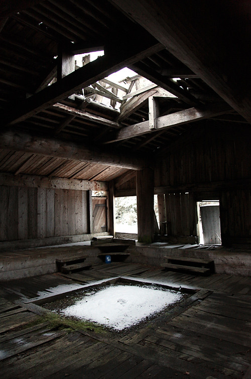 snow inside Naay I'waans, Chief Son-i-Hat Whale House, Kasaan, Alaska