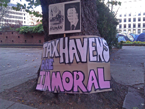 Tax havens are immoral poster on tree