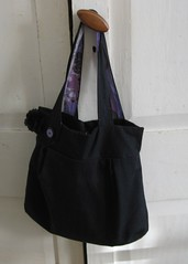 .Wasp bag in black outer and floral inner fabric.