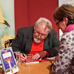 Alasdair Gray signing Fleck | Alasdair Gray signing his book